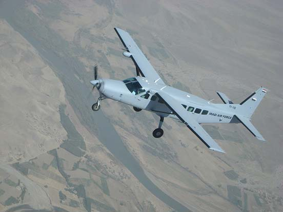 An Iraqi Air Force Cessna 208 flies over Iraq on a training sortie.