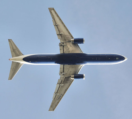 Planform view of a British Airways 767-300 after take off, with retracted landing gear and partially deployed flaps.