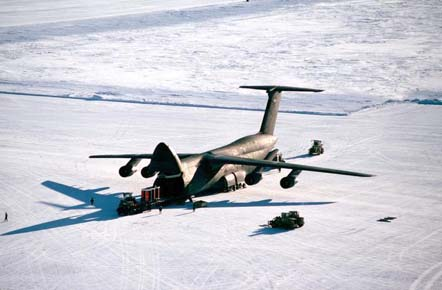 Personnel unload cargo from a C-5 Galaxy on an ice runway near McMurdo Station, Antarctica in 1989.