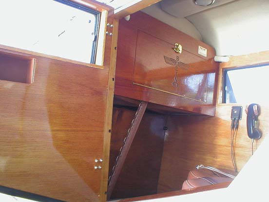Model 40C front seat of rear passenger cabin showing the fold-down writing desk/table.