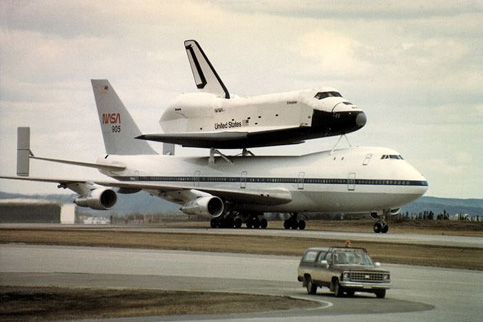 A U.S. Space Shuttle mounted on a specially modified Boeing 747