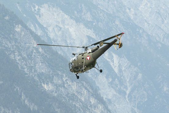 Austrian Alouette III over the Alps