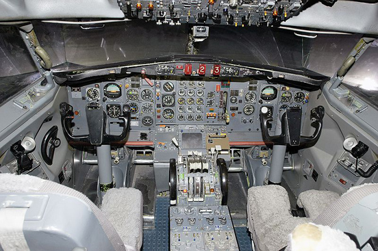 Interior close-up photo of the pilot and co-pilot area of a flight simulator for a Boeing 727 at the Pan Am International Flight Academy