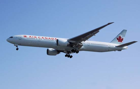 An Air Canada 777-300ER landing with flaps deployed