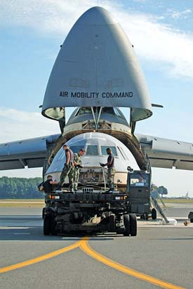 The flight deck from the C-5B crash at Dover AFB in April 2006 being loaded into a C-5.