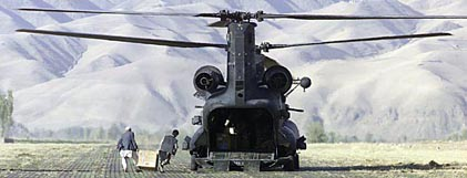 A U.S. MH-47D stands ready to receive medical supplies in Feyzabad, Afghanistan.
