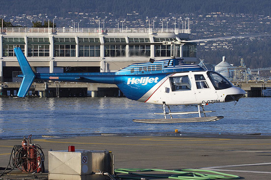 Bell 206B JetRanger taking off from Vancouver Harbour HeliJet pad.
