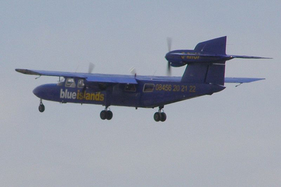 A Trislander, operated by Blue Islands Airline, departing Shoreham Airport, Shoreham-by-Sea, West Sussex, England.