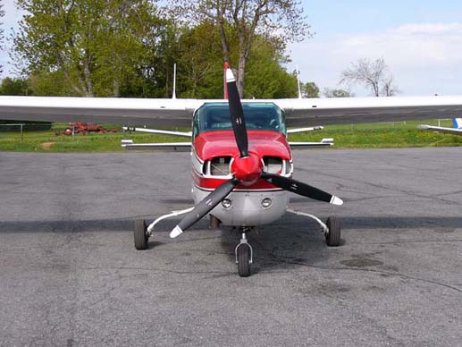 A Cessna T210L shows the later model's strutless cantilever wing