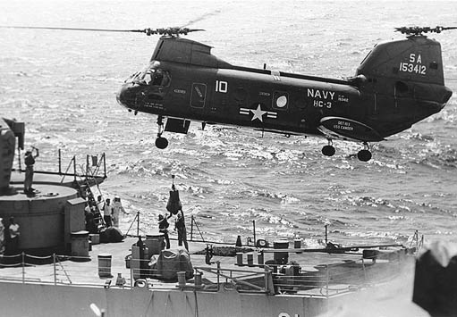 A UH-46D lowers mail to the fantail of USS Decatur.
