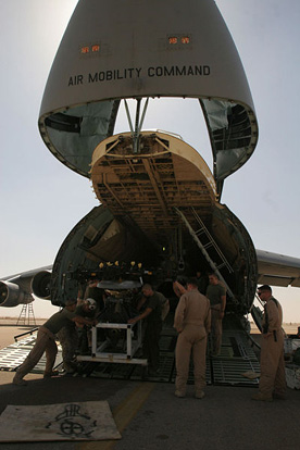 The forward section of the C-5 Galaxy lifts open to allow loading of bulky items, such as this load of 3 CH-46 helicopters.