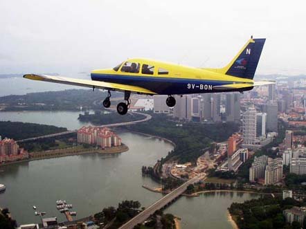The PA-28-161 Warrior II flying in the livery of the Singapore Youth Flying Club. The Warrior II is still widely used in basic flying training worldwide.