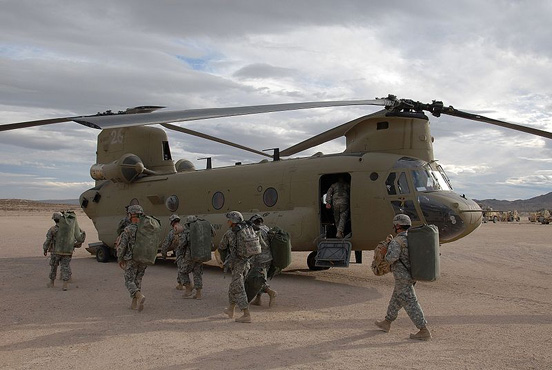 Soldiers prepare to board a CH-47F at the National Training Center, Fort Irwin, Calif., November 2007.