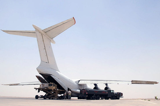 A commercial variant of Ilyushin Il-76 loading cargo at Ali Base in Iraq
