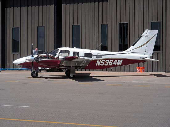 Piper Seneca at Centennial Airport undergoing engine maintenance
