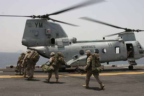 US Marines from the 24th MEU prepare to board a CH-46.