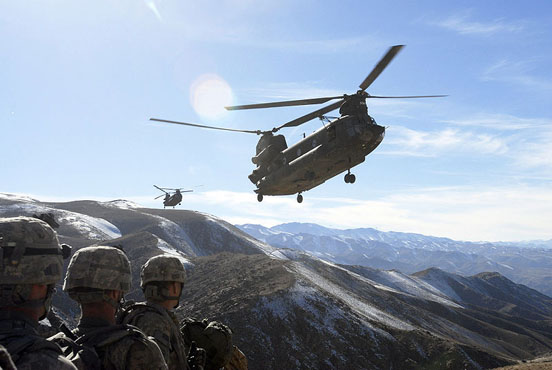 Soldiers wait for pickup from two Chinooks in Afghanistan, 2008.