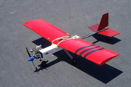 This homebuilt high-wing model is an example of the concept of Simple Plastic Airplane Design where readily available and easily workable materials are used to create a simple, rugged airframe