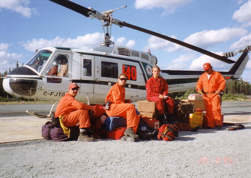 A Bell 205A-1 with its helitack firefighting crew on standby with the Ontario Ministry of Natural Resources at Sioux Lookout, Ontario, 1995