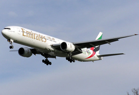 An Emirates 777-300 landing at London Heathrow Airport