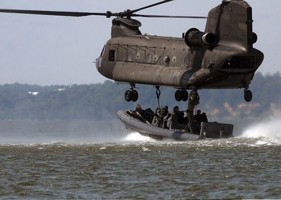 A CH-47 Chinook in a training exercise with US Navy Special Warfare (in rigid-hulled inflatable boat) and 159th Aviation Regiment personnel, Virginia Capes, Virginia, July 2008.