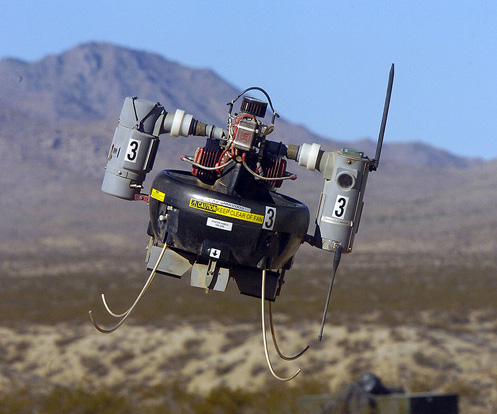 Naval Air Weapons Station China Lake, California - A Micro Air Vehicle (MAV) flies over a simulated combat area during an operational test flight. The MAV is in the operational test phase with military Explosive Ordnance Disposal (EOD) teams to evaluate its short-range scouting capabilities.