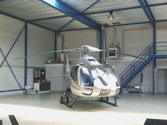 An Eurocopter EC 130 operated by Heli Holland in a hangar at Lelystad Airport
