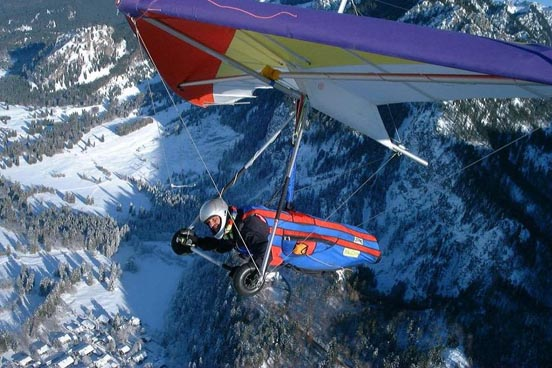 A basic flexible-wing glider flying over the Alps, 2006.