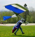 Exxtacy rigid wing glider, showing flaps and spoilerons, flares for a smooth landing; 2001.