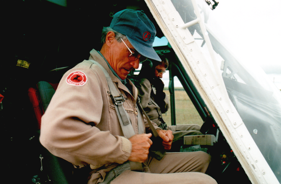 A Bell 212 crew from Alpine Helicopters scrambles on a medevac mission. Both the aircraft captain (left) and the copilot in this case are holders of the Airline Transport Pilot Licence - Helicopter.