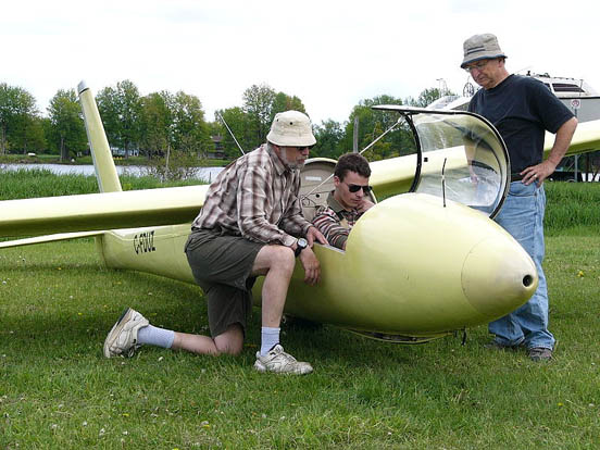 A Canadian glider pilot is ground briefed prior to solo in a Schweizer SGS 1-34 sailplane