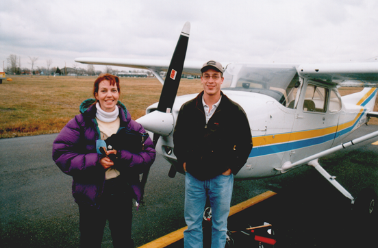 A Canadian aeroplane flight instructor (left) and her student, with the Cessna 172 they have just completed a lesson in.