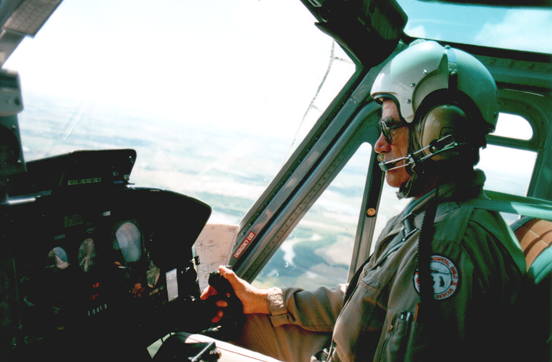 A Canadian pilot who holds an Airline Transport Pilot Licence - Helicopter, flying a Bell 212 on a medevac mission.