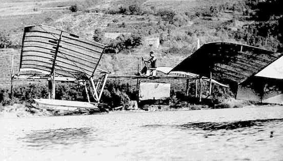 Glenn Curtiss or an assistant coaxes the structurally modified Langley Aerodrome into the air above the surface of Keuka Lake near Hammondsport, N.Y., September 17, 1914.