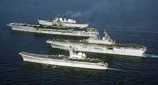 From bottom to top: Principe de Asturias, amphibious assault ship USS Wasp, USS Forrestal and light V/STOL carrier HMS Invincible, showing size differences of late 20th century carriers