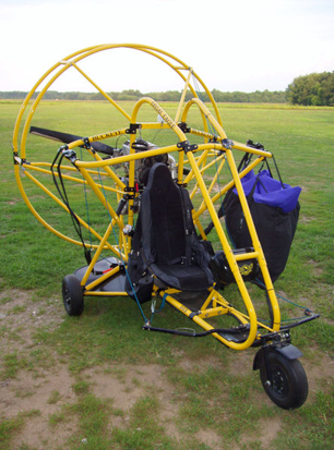 A powered parachute with its wing stowed.