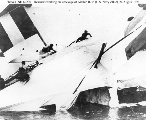 Rescuers scramble across the wreckage of British R-38/USN ZR-2, 24 August 1921