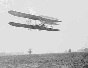 Wilbur flying almost four circles of Huffman Prairie, about 2 and 3/4 miles in 5 minutes 4 seconds; flight #82, November 9, 1904.