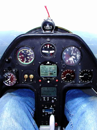 Schempp-Hirth Janus-C in flight, showing instrument panel equipped for