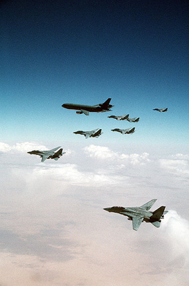 F-14 Tomcats from the Red Sea and Persian Gulf await their turn refueling from a KC-10A over Iraq during Desert Storm.
