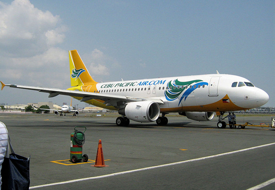 A Cebu Pacific airplane on the runway at Ninoy Aquino International Airport.