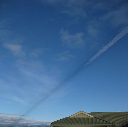 A shadow cast by vapour trail.