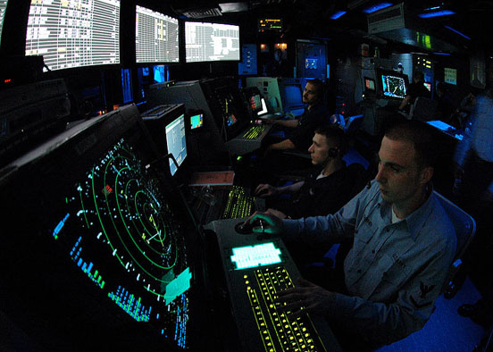 A military air traffic controller works approach controller in Carrier Air Traffic Control Center (CATTC) aboard the Nimitz class aircraft carrier USS Abraham Lincoln (CVN 72).
