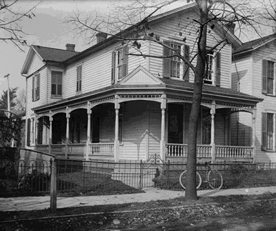 Wright brothers' home at 7 Hawthorn Street, Dayton about 1900. Wilbur and Orville built the covered wrap-around porch in the 1890s.