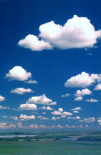 Good gliding weather: Well-formed cumulus humilis, with darker bases, suggests active thermals and light winds.