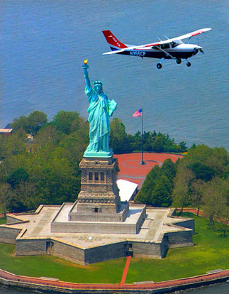 A Civil Air Patrol Cessna 182 Skylane flies over the Statue of Liberty after the attacks of September 11, 2001