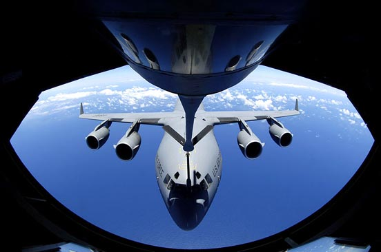A C-17 Globemaster refuels through the boom of a KC-135 Stratotanker