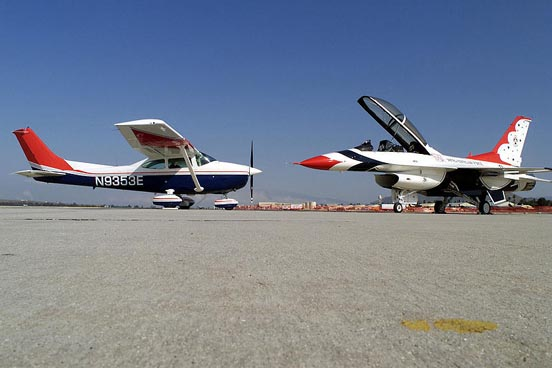A Civil Air Patrol Cessna 182 poses with U.S. Air Force Thunderbirds Number 8 at March Air Reserve Base, March 2000