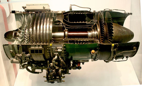 A General Electric J85-GE-17A turbojet engine. This cutaway clearly shows the 8 stages of axial compressor at the front (left side of the picture), the combustion chambers in the middle, and the two stages of turbines at the rear of the engine.