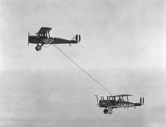 Capt. Lowell H. Smith and Lt. John P. Richter receiving the first mid-air refueling on June 27, 1923, from a plane flown by 1st Lt. Virgil Hine and 1st Lt. Frank W. Seifert.